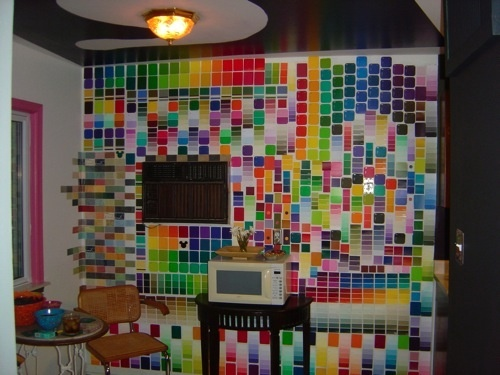 Ohhhkay, I do not wish to have a wall that looks just like this in my home, but I like the idea of making a focal/accent wall out of paint chips. They're used for small or large pieces of art, and small crafty things, but why not go for a whole wall? Just, maybe different colors, eh?