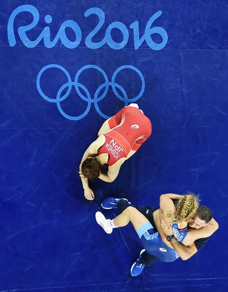 Saori Yoshida of Japan places her head down on the mat after losing to Helen…
