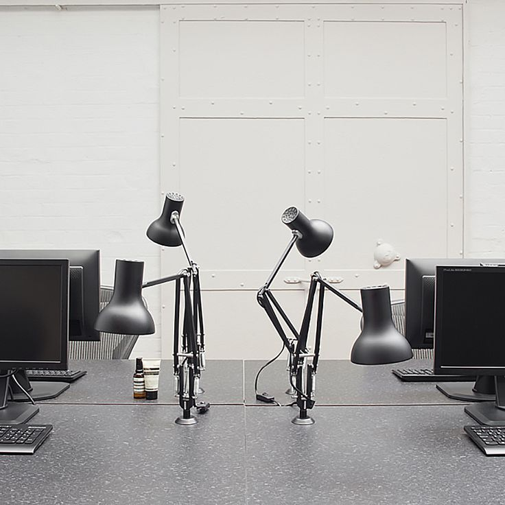 Jet Black Type 75™ Mini Desk Lamps with desk inserts at Aesop's UK headquarters. http://www.domesticoshop.com/