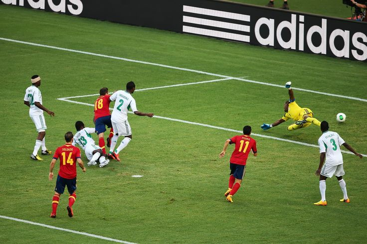 Jordi Alba of Spain scores during the FIFA Confederations Cup Brazil 2013 Group B match between Nigeria and Spain at Castelao on June 23, 2013 in Fortaleza, Brazil.