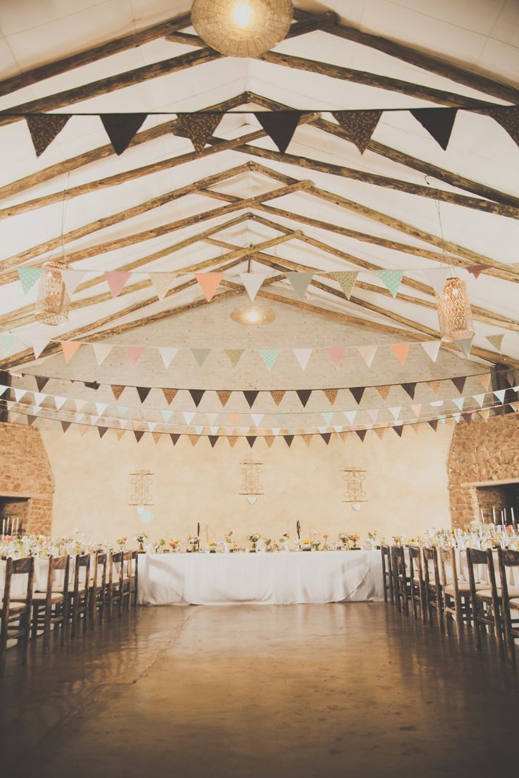 Megan & Waldo's wedding at Imperfect Perfection with bunting in the hall. Photo by Blackframe Photography