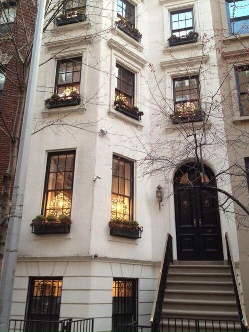 New York - window boxes; all white exterior w black door and black windows