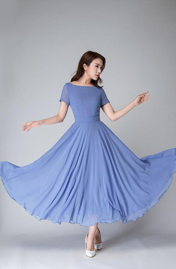 This Blue maxi dress is hand crafted with soft chiffon in a blue hues , featring short sleeve, boat neck line, The fit and flare desigh will give you a