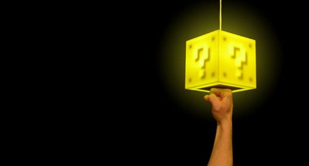 """THE SUPER MARIO COIN LAMP  """"Luigi, get down Ikea""""    Super Mario might be a short, overweight, pixelated plumber but that doesn't stop us respecting him.    And now you can make like Mario with your very own question mark block light. The custom made touch-sensitive lamp is 6in x 6in x 6in, and made of laser-cut plexiglass and lit from inside by energy efficient LEDs. The lamp is suspended from an integrated 11ft power cord, so you can hang it from a hook on your ceiling."""