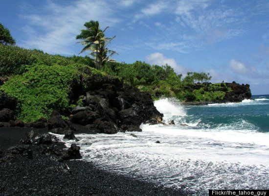 Punalu'u Beach, also known as Black Sand Beach, is composed of black basalt sand, formed from volcanic lava.