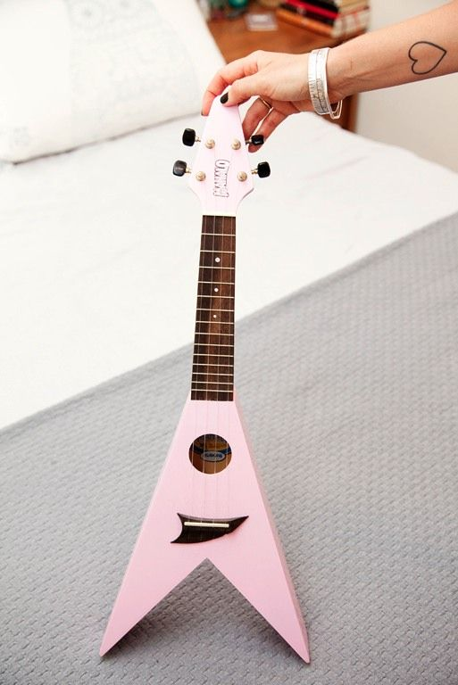 Pink flying v child's guitar