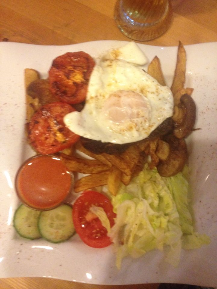 Beef steak with bacon, egg, mushrooms and fried tomatoes