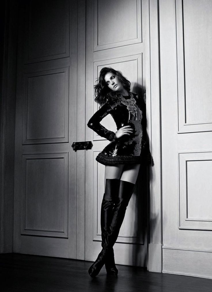 Little Black dress takes on thigh-high black leather boots ...