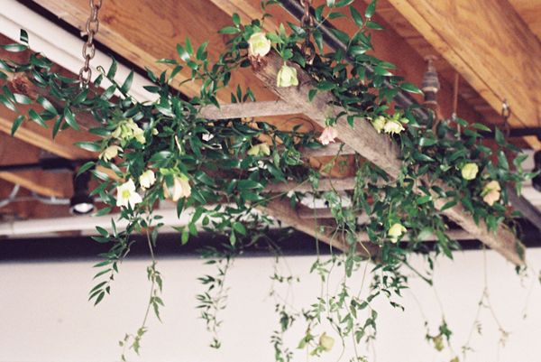 Suspend an antique ladder and weave vines through it to create a rustic trellis - perfect for a wedding in the country.