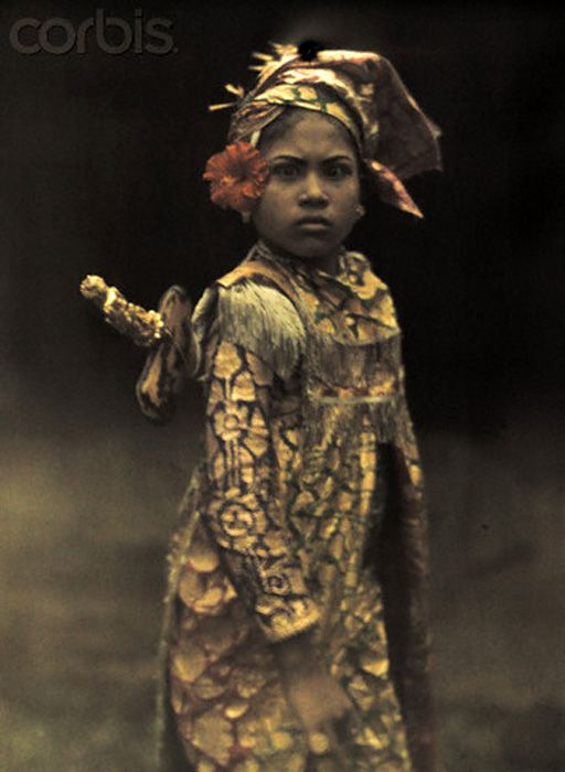 The First Color Photos of Bali, Indonesia in 1920s, 1928, Bali, Indonesia --- A child preformer dresses in costume for a role in an island play --- Image by Franklin Price Knott
