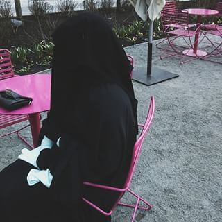 Sitting at a Pink Table