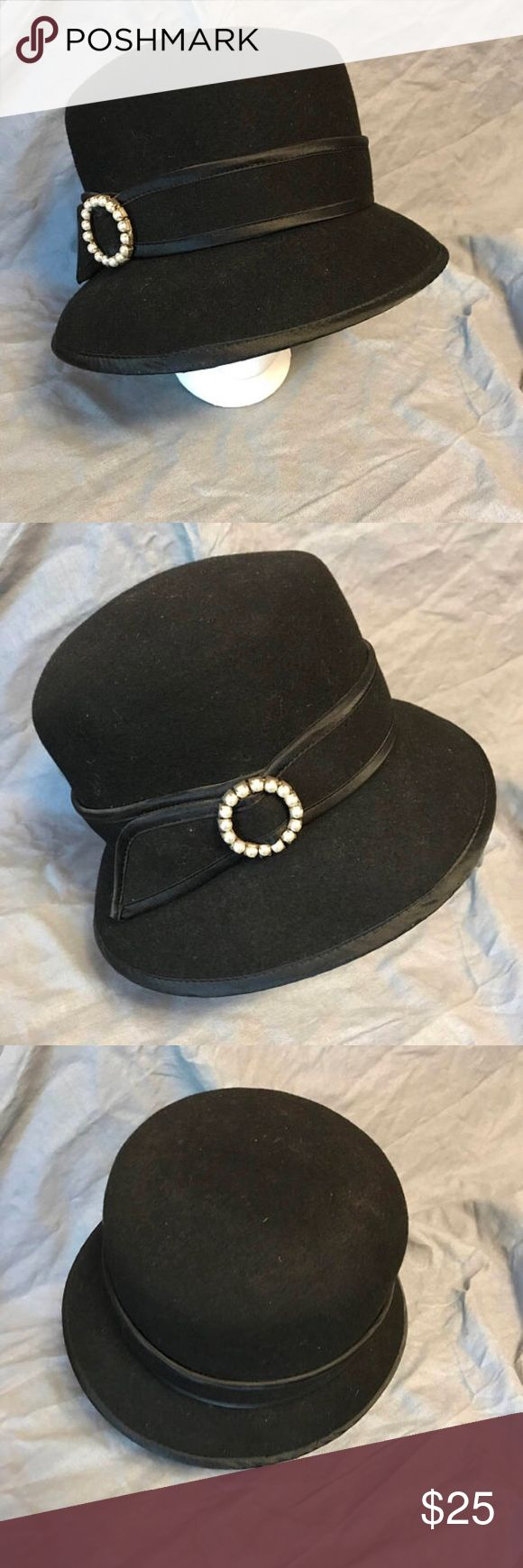"VTG pillbox hat with Faux Pearl accent Vintage pill box hat, black with pearl accessories on the side.  Super cute and classy! Perfect for a cool evening out.  Inside head circumference is 22"". Brim is asymmetrical and about 11"" across. About 5"" tall.  I photoed as many of the measurements as I thought were relevant, but please feel free to message me if you'd like additional measurements. Comes from a smoke-free, dog-friendly home. Betmar New York Accessories Hats"