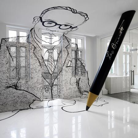 clever wall design for lobby with oversize pencil sketch!