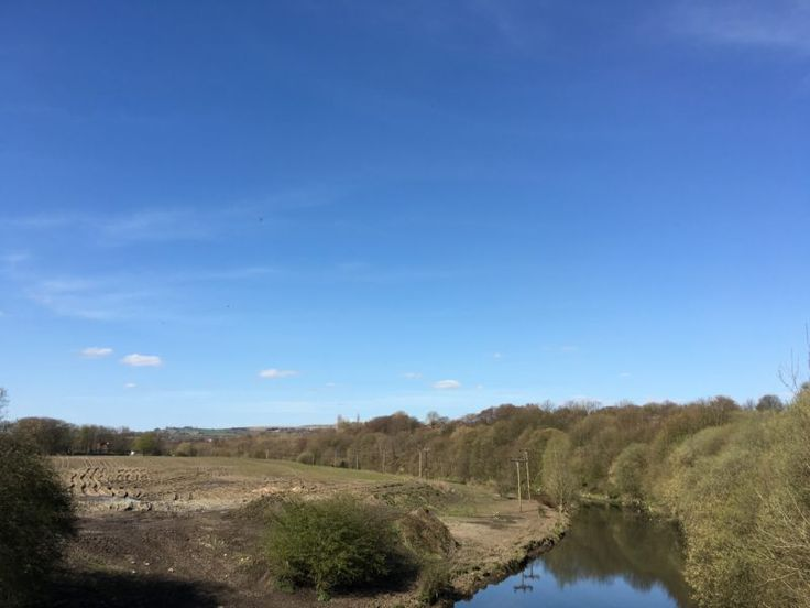 Blue sky over a river from www.sugardustandstarlight.co.uk