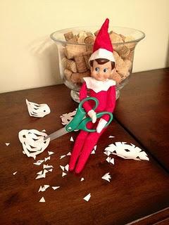 Elf making snowflakes