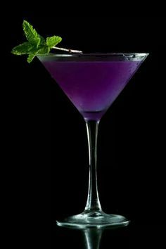Halloween Cocktail Purple Martini 3 Ounce Vodka - 1 1/2 Ounce Cranberry Juice - 1/2 ounce Blue Curacao Liquer - 1/2 ounce Sweet and Sour mix - 1/2 ounce soda 7-up.