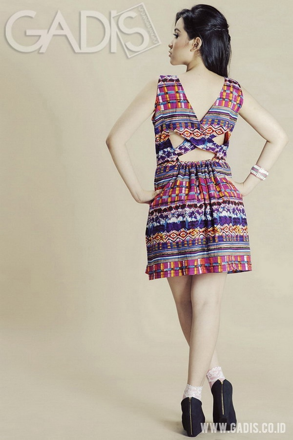 Get flirty edgy on your date with this unique cut tribal dress!