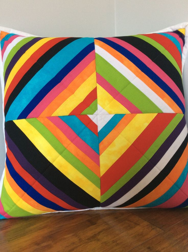 Handcrafted patchwork cushion cover.  Multicoloured strips with a black back and white binding.