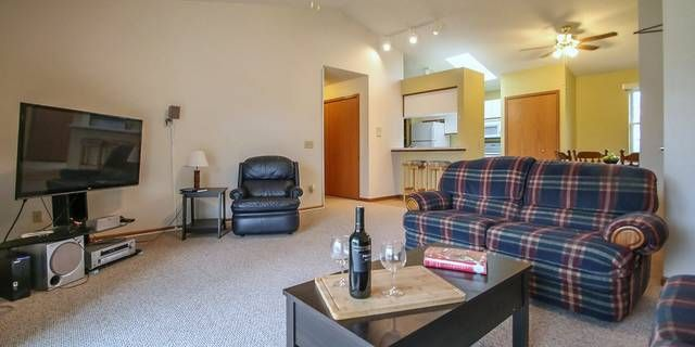 973 Park St. Unit 202 Oregon, WI 53575  Be amazed with this garden style condo with 2 bedrooms & 2 bath in Heather Grove area. Vaulted ceilings & skylight in the kitchen brightens the space. Nice balcony is accessible from the living room. Galley kitchen has white cabinets, breakfast bar, & great pantry storage. Large master suite has a private bath and walk­-in closet + another bedroom & full bathroom. Over-sized 1 car attached garage for storage. Just minutes from Madison with easy access…