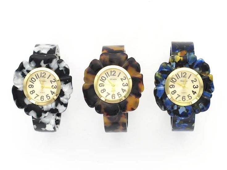 Mottled Finish Floral Watch - With a  delicate flower petal face this watch is perfect for the woman on the go!  Made from a lightweight but durable acetate , this watch is a perfect combination of fashion and functionality. Available in Navy, Tortoise, and Black.