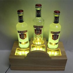Wood LED 3-Bottle Glorifier Wood LED bottle glorifier, fitted with 3x 150px(Dia.) bottle holes, with total 27pcs 5mm(Dia.) LED uplit and face lit the bottles, powered by a 12V/1,000mA adapter(included).