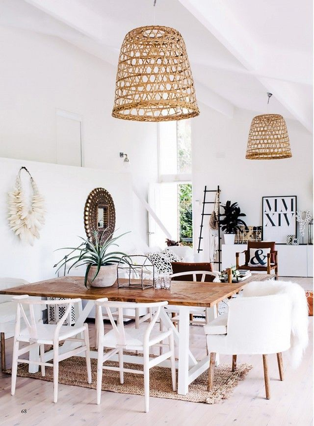 Bright bohemian dining space with matching rattan pendant lights