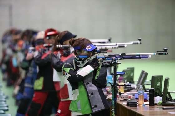 Shooters take aim during the 10-meter air rifle qualification at Olympic Shooting Centre. - Geoff Burke, USA TODAY Sports
