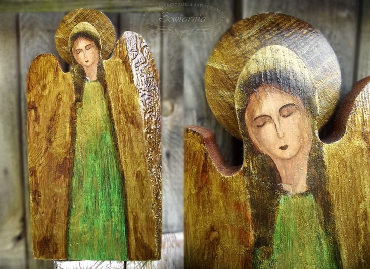 Green angel painted on reclaimed wood