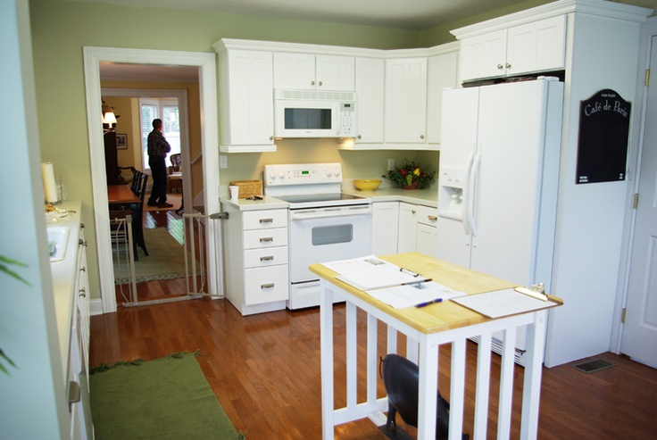 White kitchen cabinets with white applicances - another option, but I think staining to espresso would look better