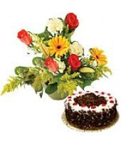 Seasonal Flower Arrangement ( consisiting of 4 Roses, 2 Gerberas, 2 carnations with Fillers) with 1 Lb (1/2 Kg) Black Forest Cake