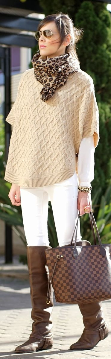 Cream cape sweater and animal prints scarf.