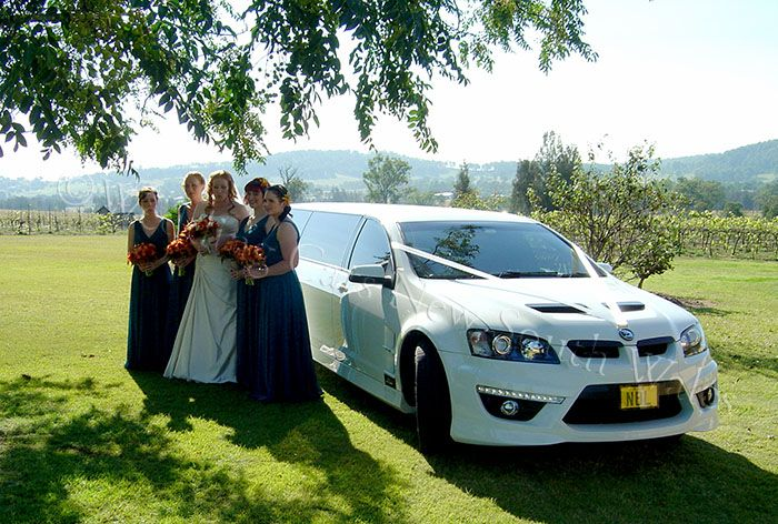 Bride & girls with the HSV limousine