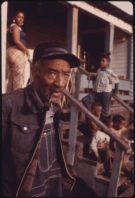 RETIRED COAL MINER ED AUSTIN WITH SOME OF HIS 20 CHILDREN IN FIRECO, WEST VIRGINIA.  1940