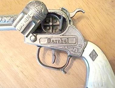 Die-Cast Metal Cowboy-Style Cap Gun. I'm pretty sure you can't buy anything even close to a realistic toy gun anymore, for obvious reasons. But these things were amazing in the 70s. Ricky Refuge, Jimmy Farr and I would watch the Lone Ranger hour on channel 45 and then play Cowboys and Indians in the backyard. I think they used to sell these at the Longhorn Ranch Steakhouse gift shop.