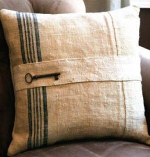 Pillow made from upcycled grain sacks and finished with a skeleton key.