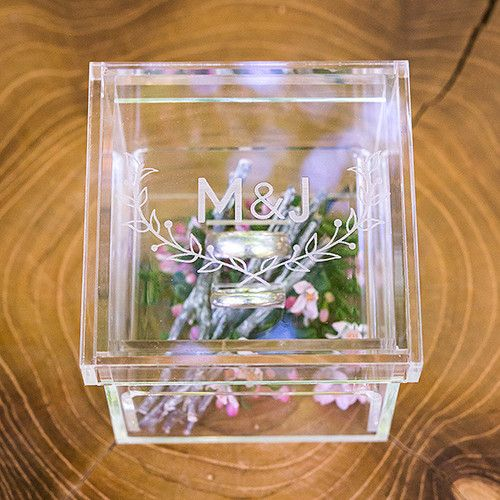 Engraved with the couples initials, this unique miniature ring box will add a touch of modern to any wedding. Add coordinating flowers to the lower section of the ring box.