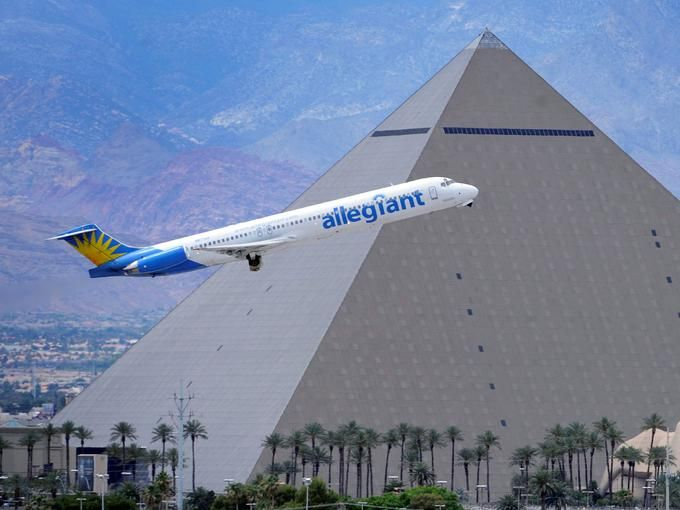 An Allegiant Air flight takes off in Las Vegas, with the Luxor Resort and Casino in the background.