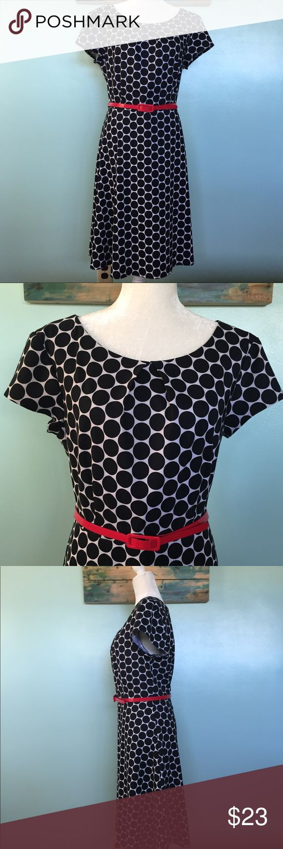 """Connected Apparel Black/White Polka Dot Dress - 14 Beautiful Connected Apparel Black and white polka dot dress with red belt. This dress has a little stretch to it.  It was gently worn a few times, but has no stains, tears or alterations.  Last two pics are only to show fitting.  Approximate measurements laying flat: shoulder to sleeve 4"""", sleeve 4 3/4"""", chest armpit to armpit 19 1/2"""", shoulder to waist 17"""", waist 17 1/2"""", waist to seam length  23 1/3"""".   ✅ Bundle & Save ✅ Open to offers ❌…"""