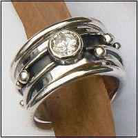 Handgemaakte zilveren ring met goud: Flower Power + 2 Amigas