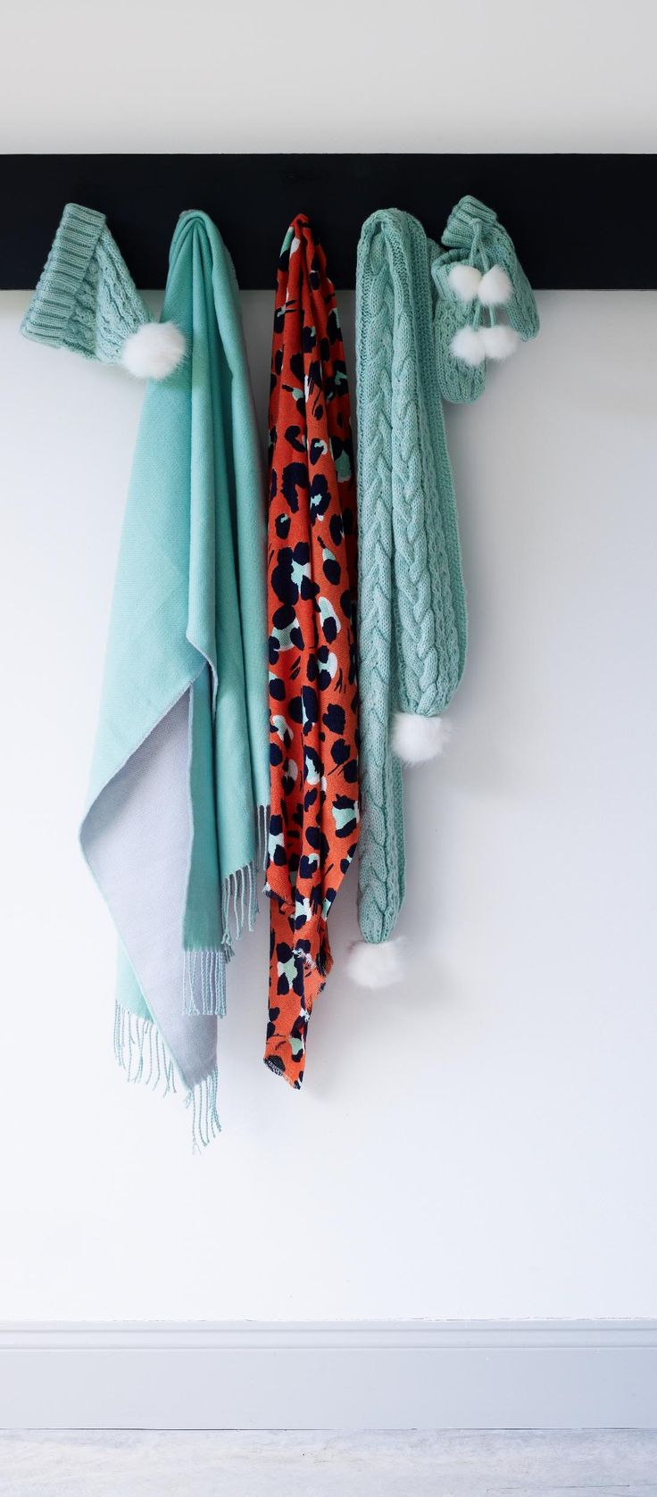 Refresh a monochrome look with our Mint Knitted Pom Pom Scarf. Featuring a chunky mint cable knit and white faux fur pom poms on the end.