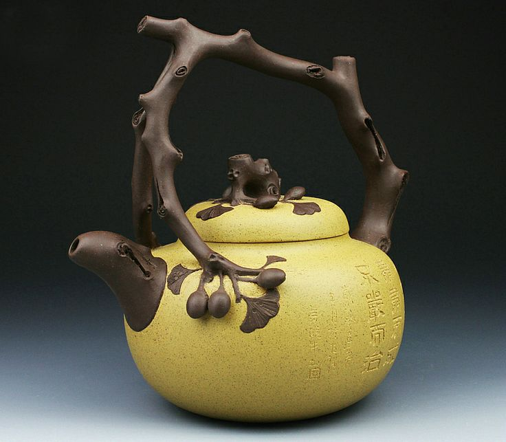 Brown and yellow clay carved ceramic collectible YiXing teapot - www.artpotterymall.com