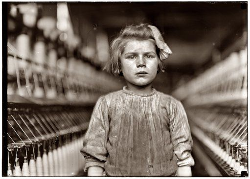 "A Little Spinner by Lewis Hine, 1909    ""This picture was taken in Globe Cotton Mill, Augusta, Georgia.  The overseer admitted she was regularly employed.""    Photo taken for the National Child Labor Commission and its report to Congress"