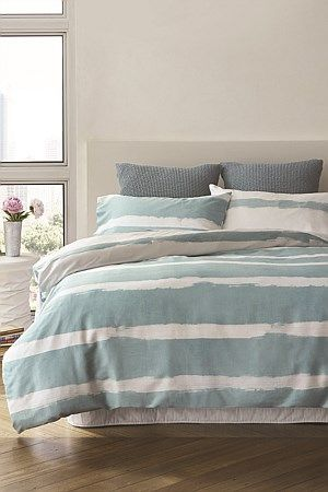This sophisticated, 100% cotton sateen duvet cover set features white painted stripes design on a duck egg blue background for an ultra modern look. 100% reversible with the inverted colours on reverse. Each set comes with two matching pillowcases.