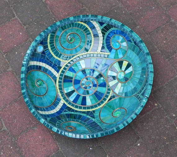 Mosaic dish made of hand cutted stained glass pieces, glass tiles and glazed ceramic tiles on bamboo dish.