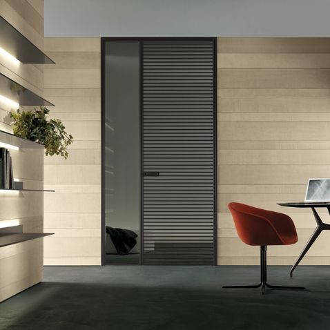 double swing door Even with brown aluminium structure and transparent grey glass.