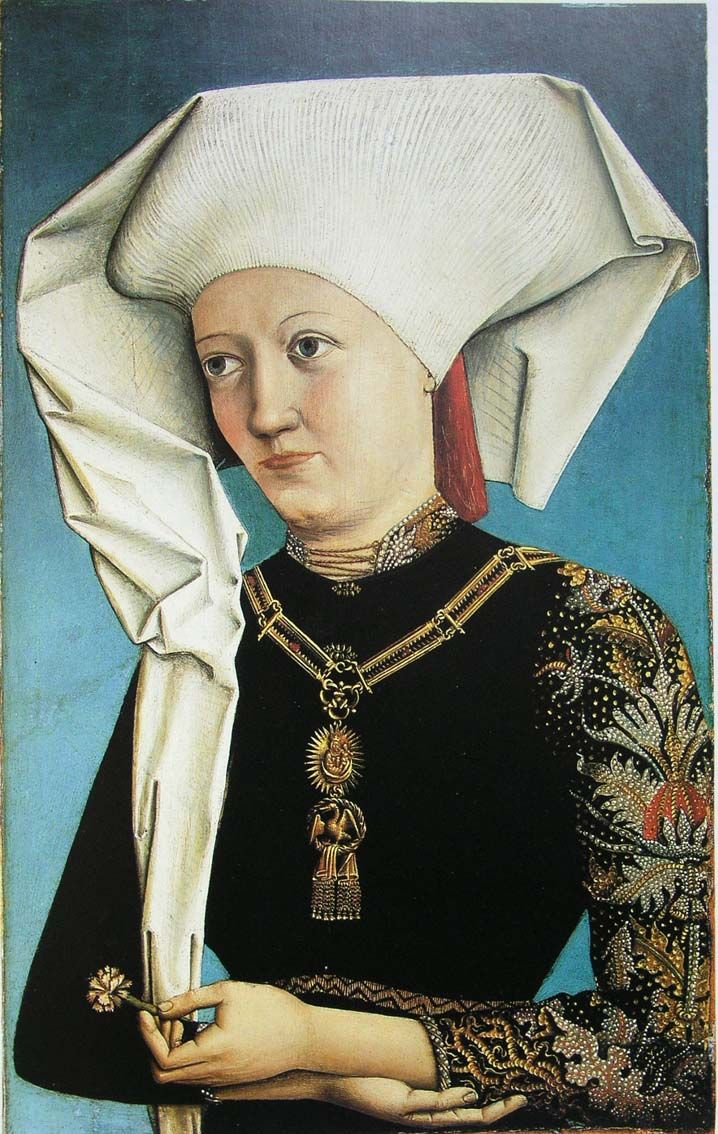 What an amazing hat, and I really like the patterned sleeves. Swabian (german duchy?) - Is this another impresa for you, Elisabetta?