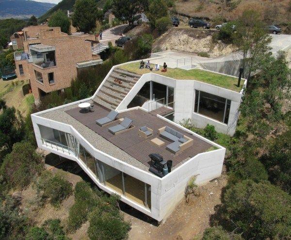 haus hanglage kosten terrasse treppen sonnenliegen möbel