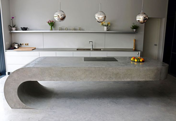 Gravity defying!  This cantilevered kitchen island is made from concrete.