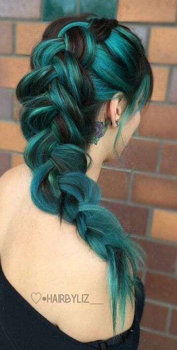 How beautiful!! We are falling in love with this amazing and unique color and style. She is rocking a sea green in a braided fohawk. Is anyone else loving this braided green hairstyle?