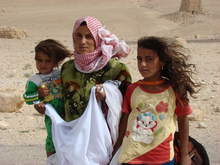 A family selling fabric at Palmyra, Syria, 2009.